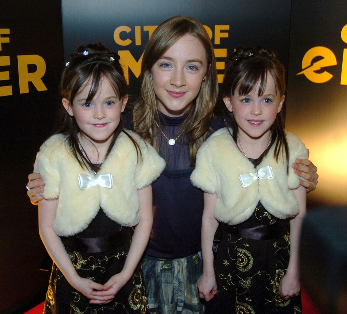 Saoirse Ronan poses with her City of Ember co-stars Amy and Catherine Quinn