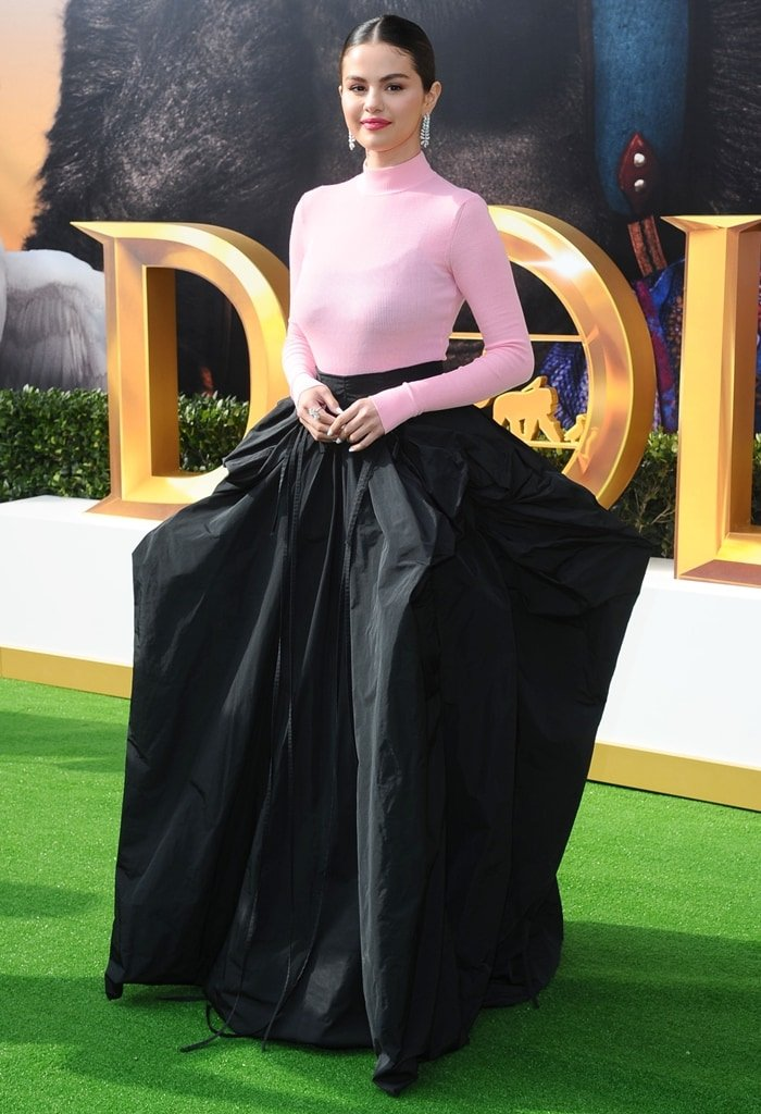 Selena Gomez donned a pink sheer turtleneck top and a voluminous black skirt from the Givenchy Fall 2019 Haute Couture collection