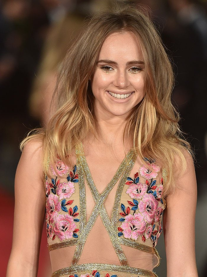 Suki Waterhouse sporting glittering gold under-eye makeup and bedhead hair
