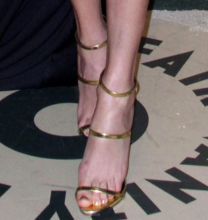 Taylor Swift's feet in strappy gold Giuseppe Zanotti heels