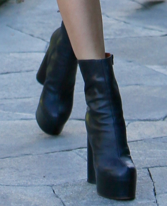 Taylor Swift rocks Vetements black leather ankle boots