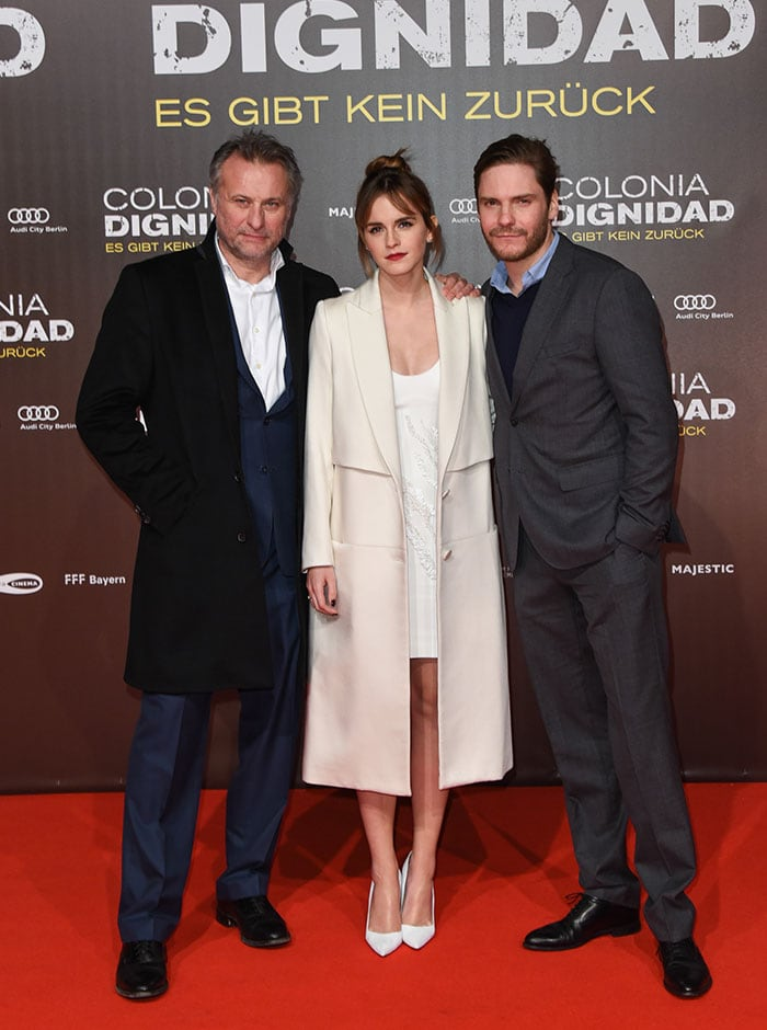 """Michael Nyqvist, Emma Watson, and Daniel Bruhl pose for photos on the red carpet at the Berlin premiere of """"Colonia"""""""