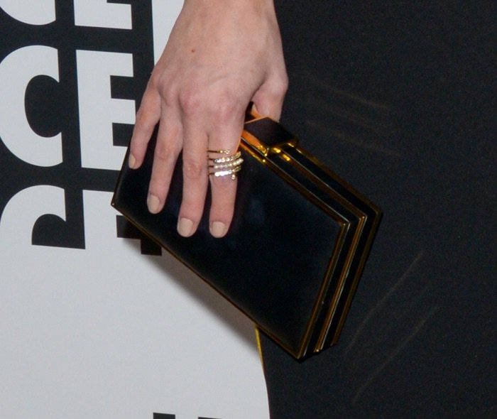 Chloe Bridges toting a black, acrylic clutch
