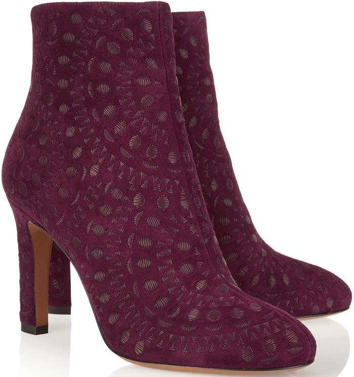 Crafted from rich merlot suede, Alaïa's Italian-made ankle boots are embroidered with a floral medallion motif