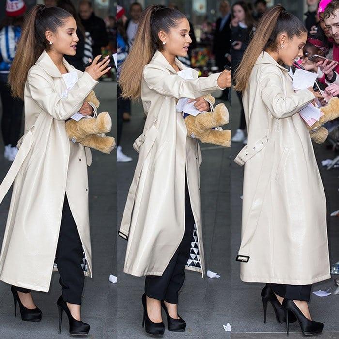 Ariana-Grande-BBC-Radio-1-trench-coat-jumpsuit