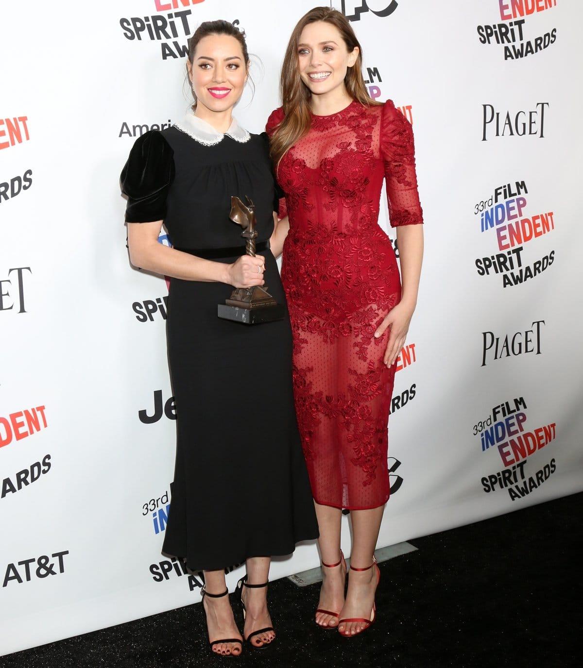 Elizabeth Olsen and her Ingrid Goes West co-star Aubrey Plaza at the 2018 Film Independent Spirit Awards