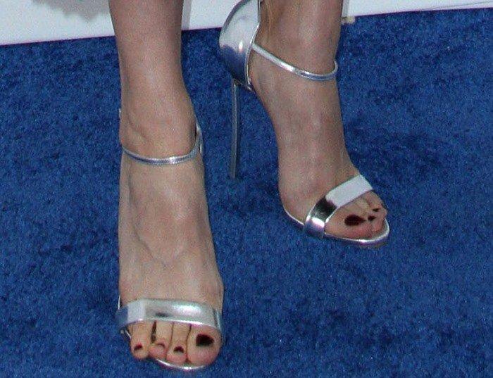 Brie Larson in silver ankle-strap Casadei sandals
