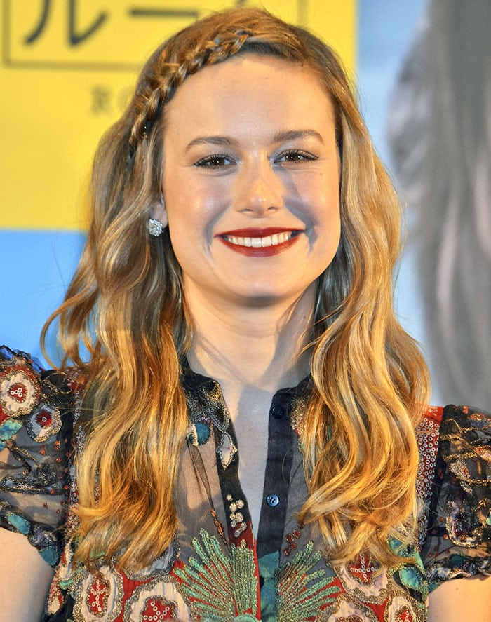 Brie Larson wore her hair down in loose waves with a chic braided headband