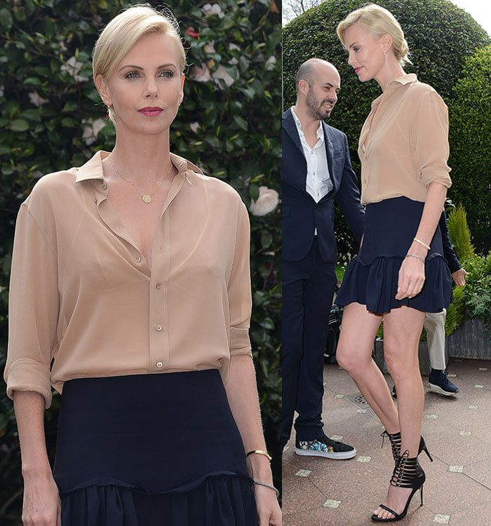 Charlize Theron's nude silk crepe de chine shirt had a few buttons left undone