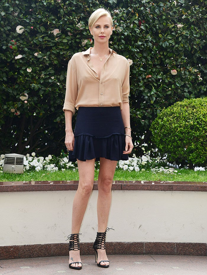 Charlize Theron's navy mini skirt with ruffled hem by Chloe