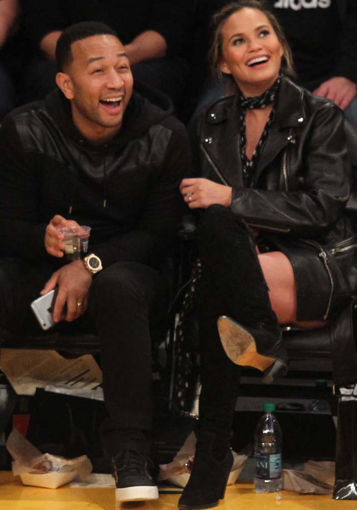 John Legend and Chrissy Teigen wear matching black outfits to a Lakers game