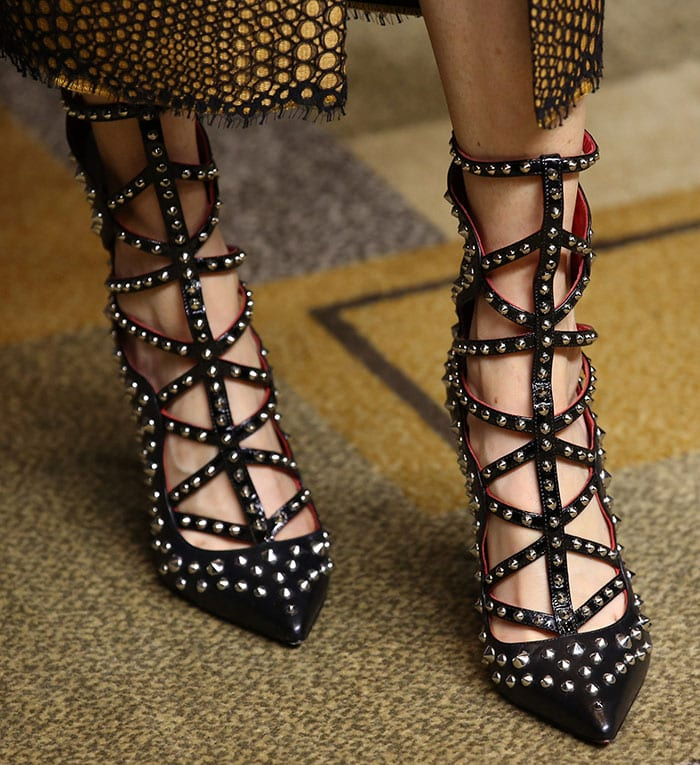 Darby Stanchfield rocks studded Cesare Paciotti shoes