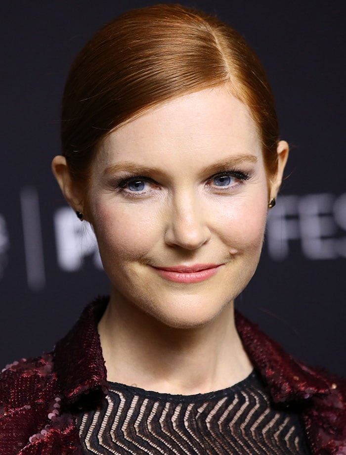 Darby Stanchfield wore her red hair in a slick side-parted ponytail