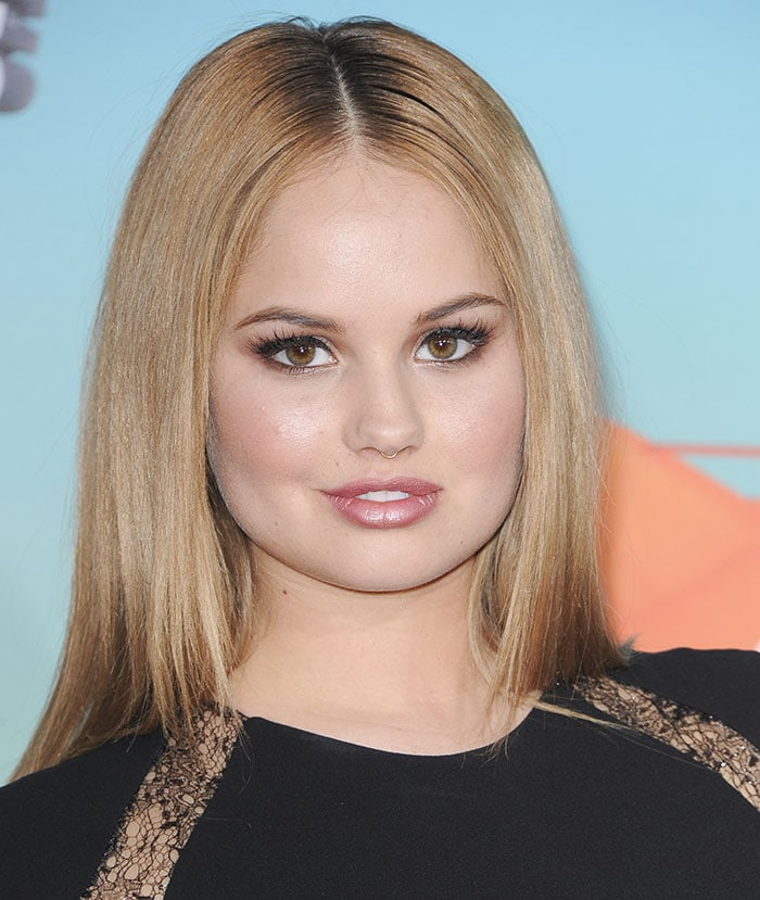 Debby Ryan's blonde locks straight and parted in the middle