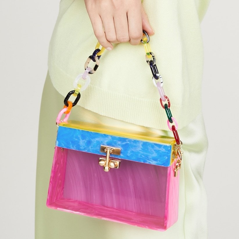 This multicolor Edie Parker bag features a moirè effect and a boxy silhouette with a gold-tone clasp