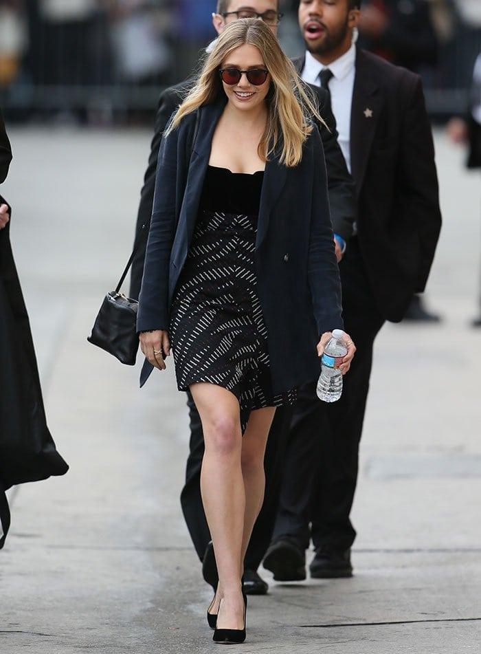 Elizabeth Olsen flaunts her legs in a mini dress by Roland Mouret and an oversized jacket by Atea Oceanie
