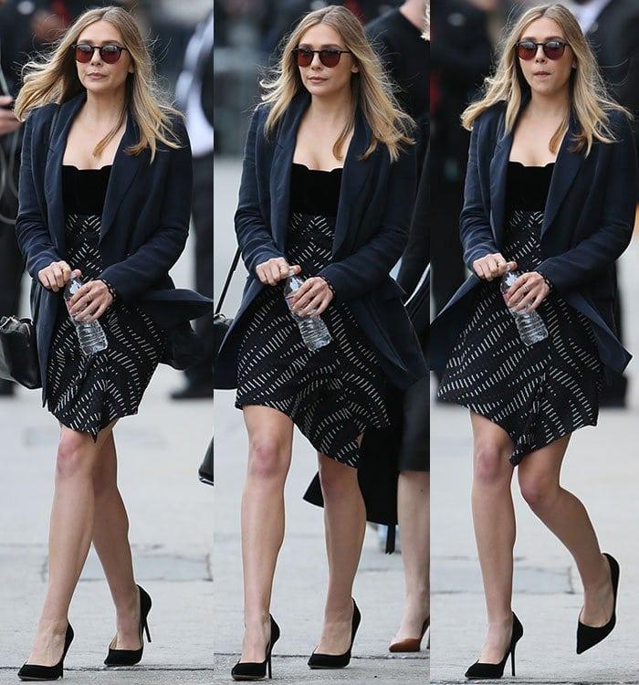 Elizabeth Olsen's Roland Mouret dress featurescutout lace sleeves