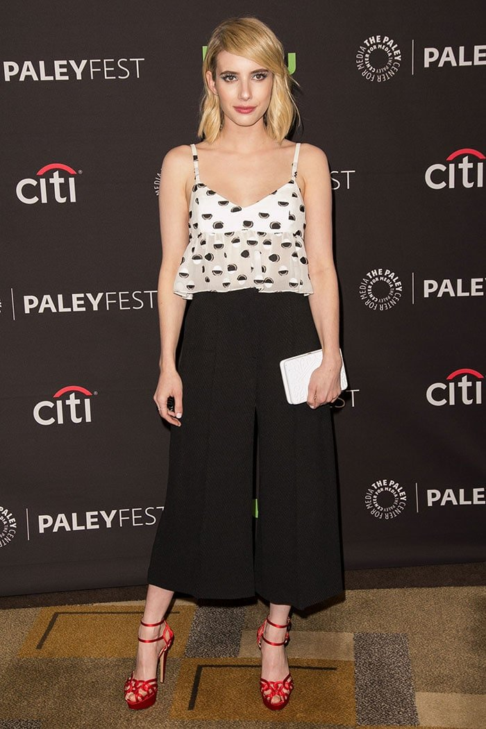 Emma Roberts wears a Thakoon peplum top with black culottes