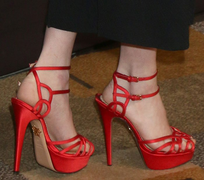 "Emma Roberts's feet in red platform ""Ursula"" sandals"