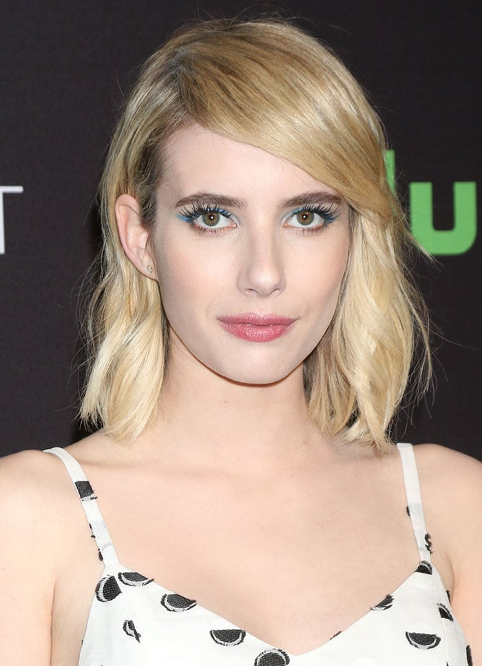 """Emma Roberts wears her blonde hair down at the """"Scream Queens"""" panel held March 12, 2016, during the 33rd Annual PaleyFest Los Angeles"""