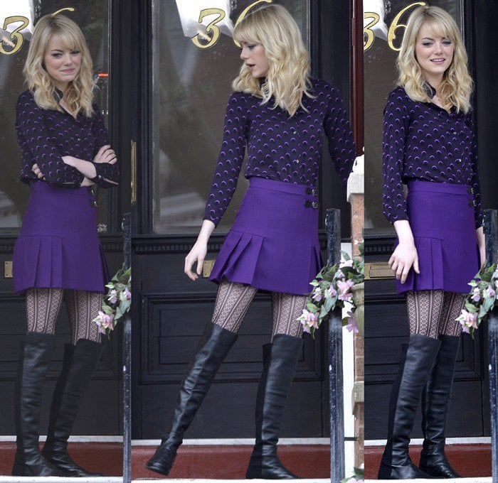 """Emma Stone pairs Stuart Weitzman boots with a purple ensemble on the set of the new """"Spider-Man"""" movie"""