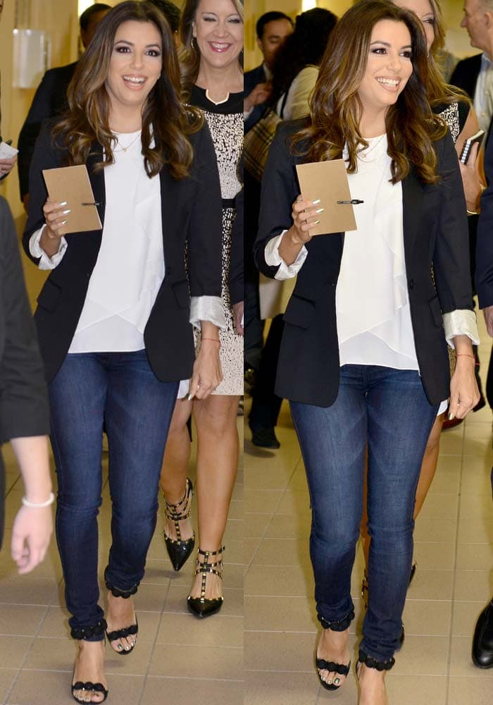 Eva Longoria wears a pair of jeans with a black blazer for a panel on climate change