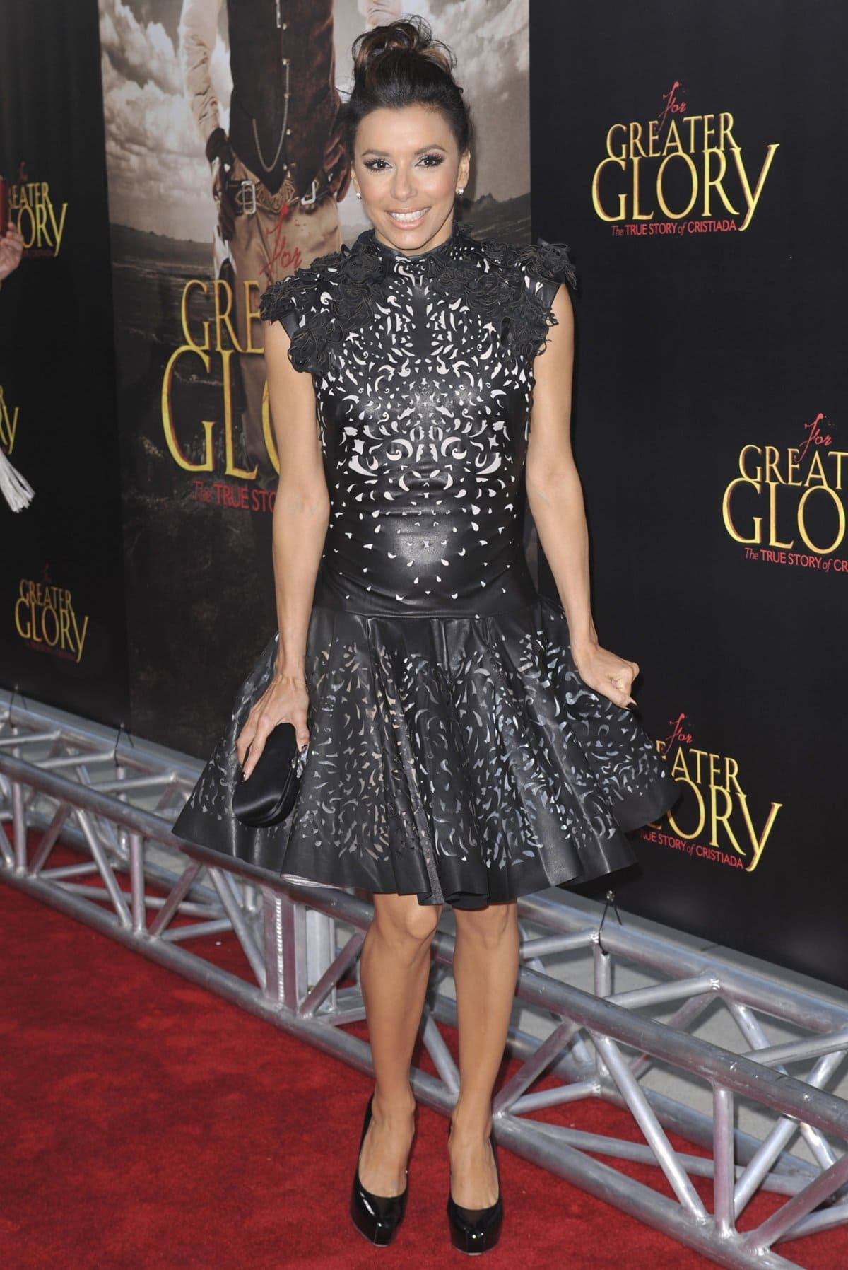 """Eva Longoria in a Marchesa Fall 2012 laser-cut dress and Brian Atwood Maniac patent pumps at the premiere of ARC Entertainment's """"For Greater Glory"""""""