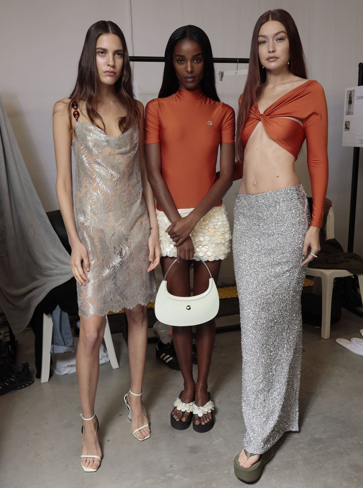 Joined by other stunning models, Gigi Hadid flaunts her toned abs backstage ahead of the Coperni Womenswear Spring/Summer 2022 show