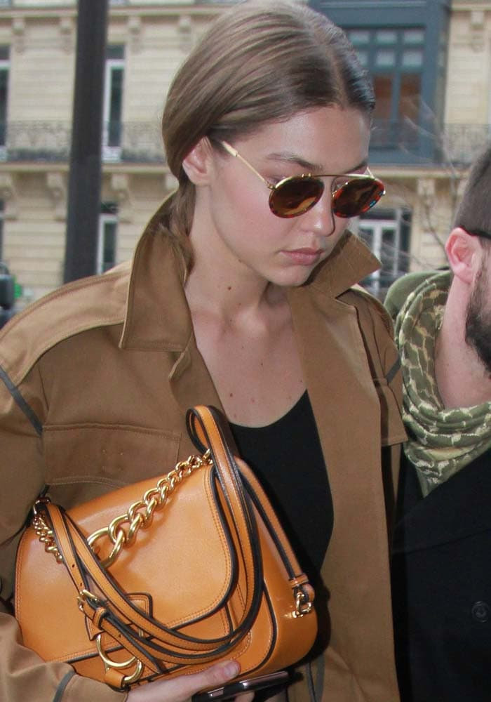 Gigi Hadid wears her hair back as she arrives at the George V Hotel in Paris