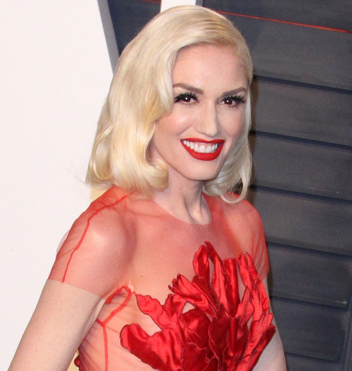 Gwen Stefani donned a red sheer gown from the Yanina Spring 2015 Couture Collection featuring applique petals