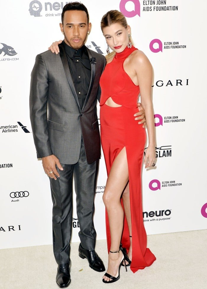 Hailey Baldwin and Lewis Hamilton pose for photos at the 2016 Elton John AIDS Foundation's Oscar Viewing Party