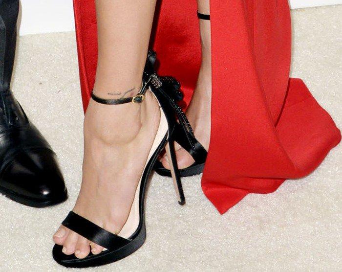 Hailey Baldwin's feet and foot tattoo in embellished black Nicholas Kirkwood sandals