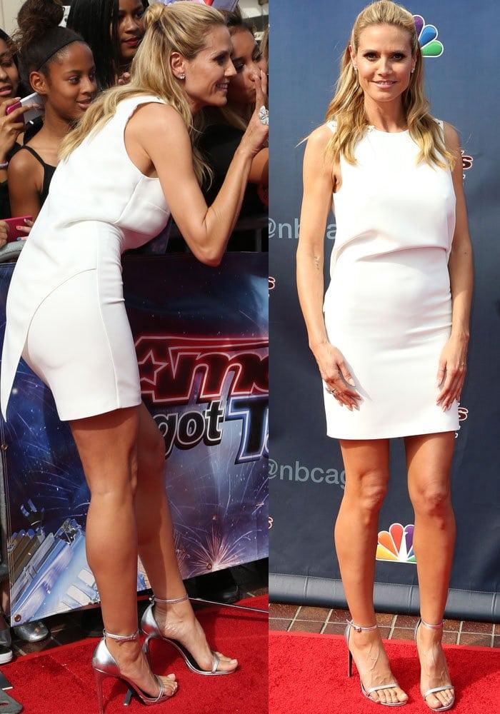 Heidi Klum wears a simple white dress on the red carpet