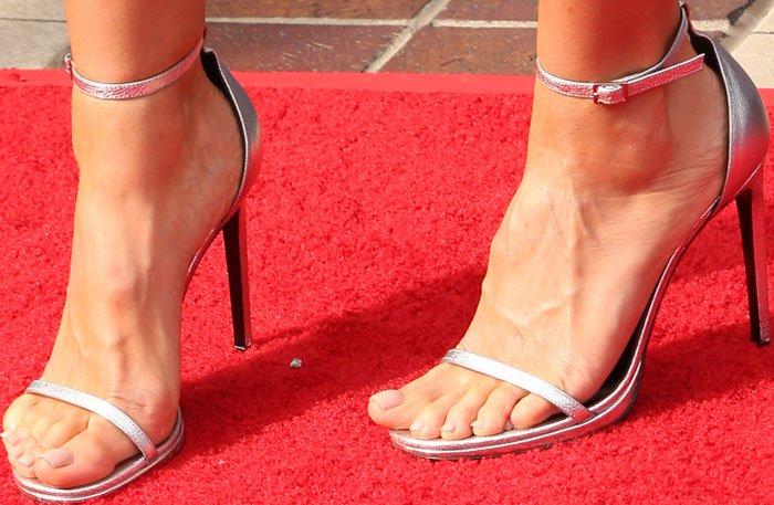 Heidi Klum's feet in silver Saint Laurent sandals