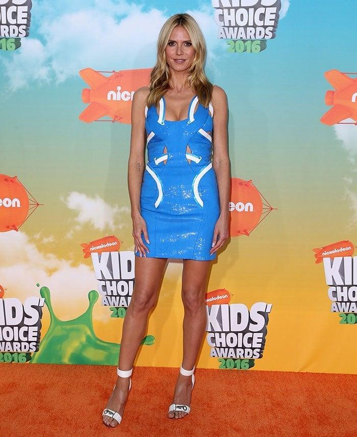 Heidi Klum wears a revealing Versace dress on the orange carpet