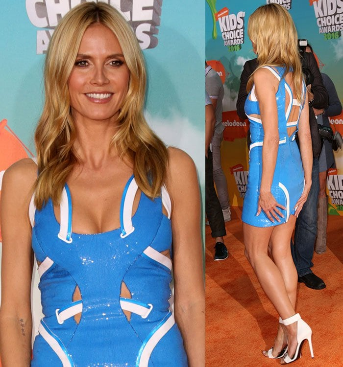 Heidi Klum shows off some skin in a blue-and-white Versace dress