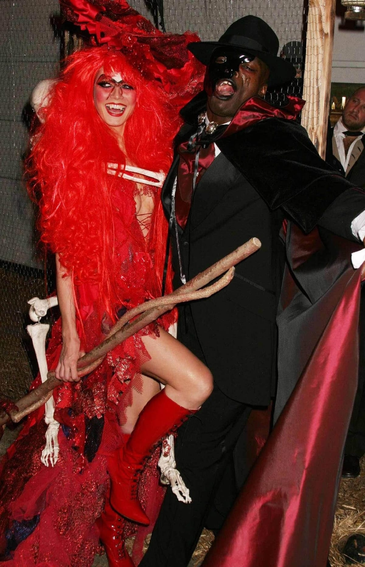 Heidi Klum as a red witch and Seal as the Phantom from The Phantom of the Opera attend her 5th Annual Halloween party