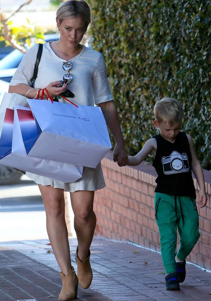 Hilary Duff shops with her son Luca at Fred Segal in Los Angeles on February 25, 2016