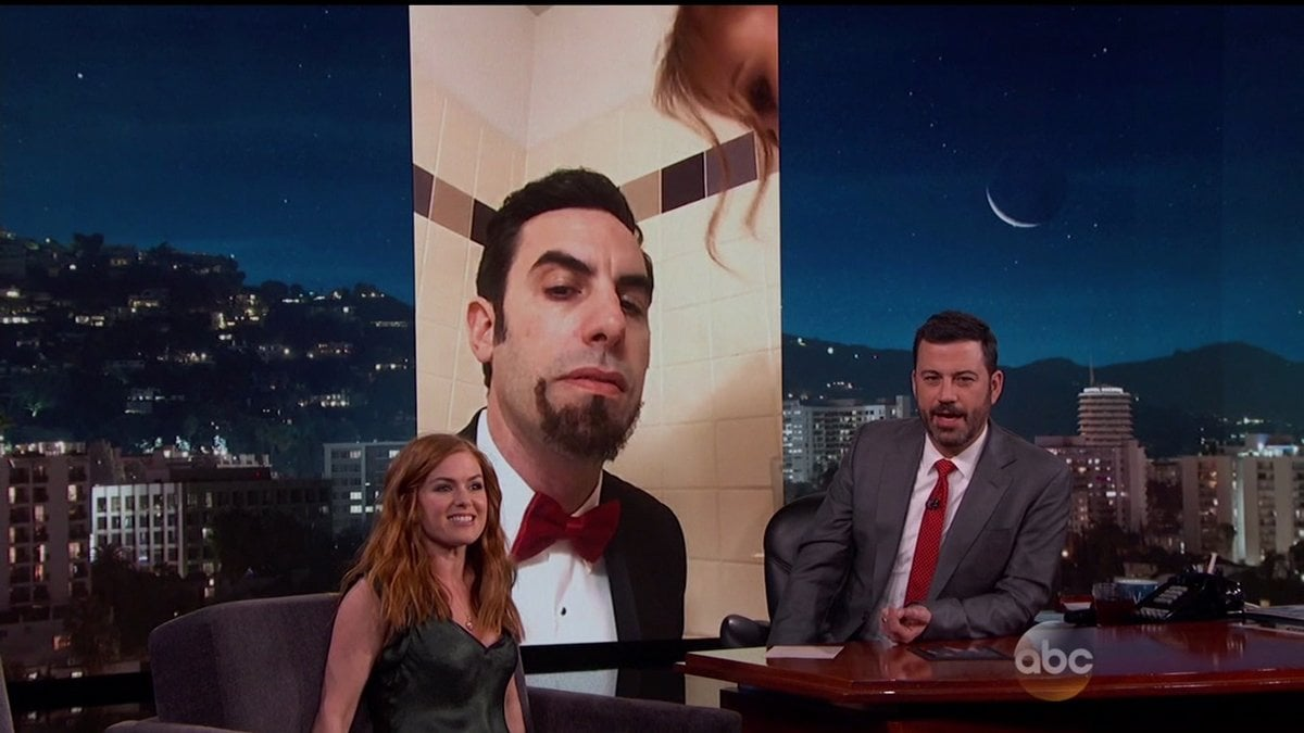 Isla Fisher told Jimmy Kimmel about sneaking Sacha Baron Cohen's Ali G costume into the Oscars