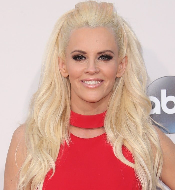 Jenny McCarthy ina red mini dress from Versace