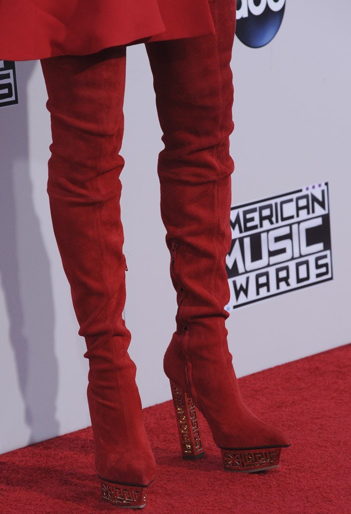 Jenny McCarthy in red stretch suede Versace over-the-knee boots