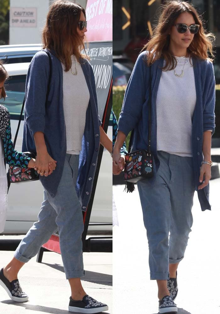 Jessica Alba wears a casual look comprised of an Inhabit cardigan and jeans while out with her family