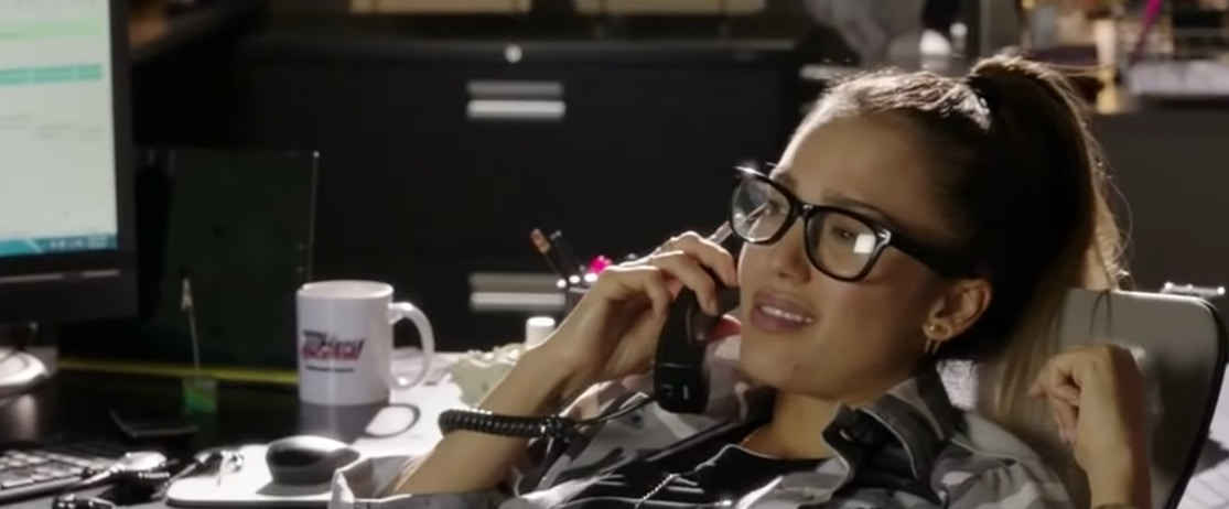 Jessica Alba as receptionist Charlie in the 2014 American comedy crime film Stretch