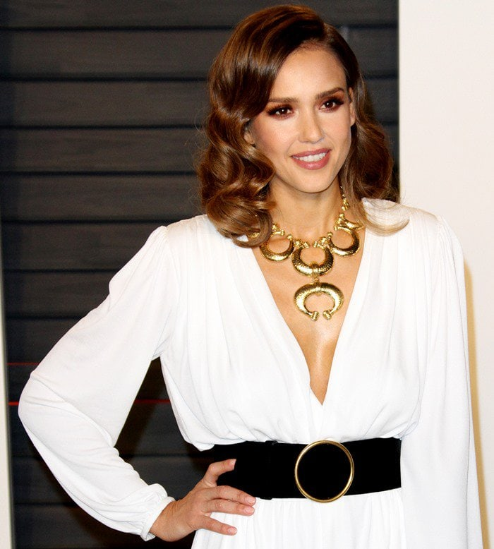 Jessica Alba styles her white Roberto Cavalli gown with a wide black belt