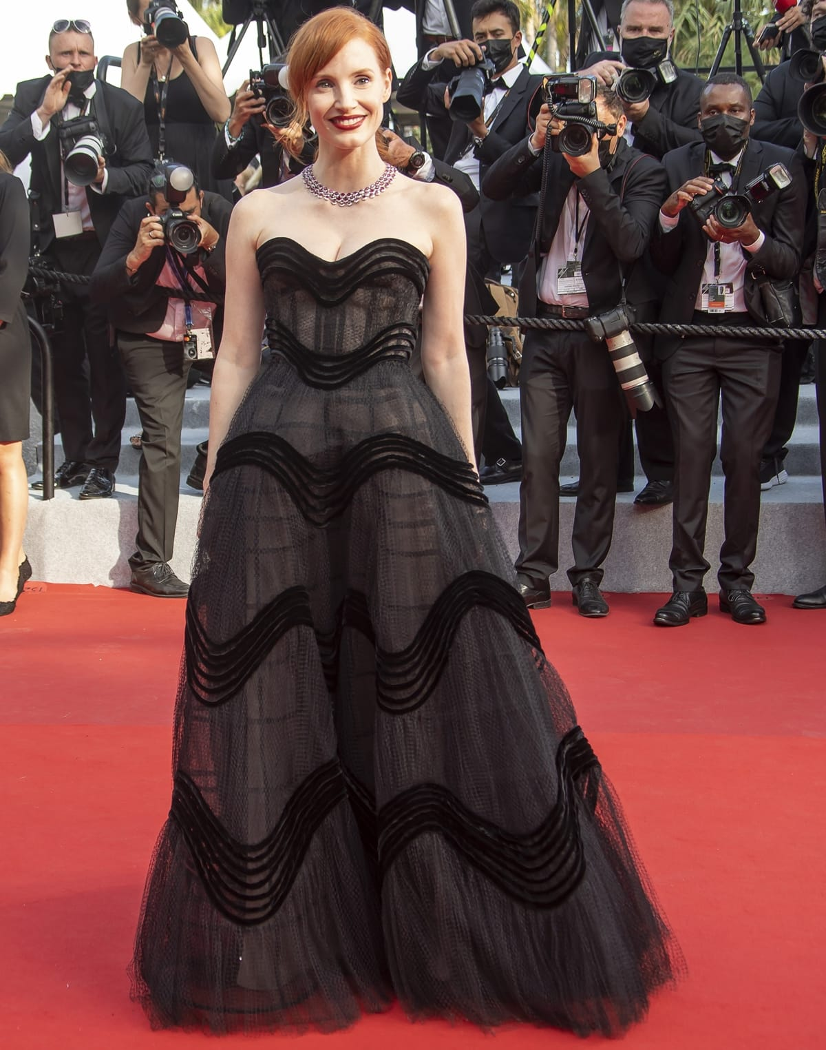 Jessica Chastain makes a grand entrance in a black Christian Dior Fall 2019 Haute Couture dress at the opening ceremony of the 2021 Cannes Film Festival