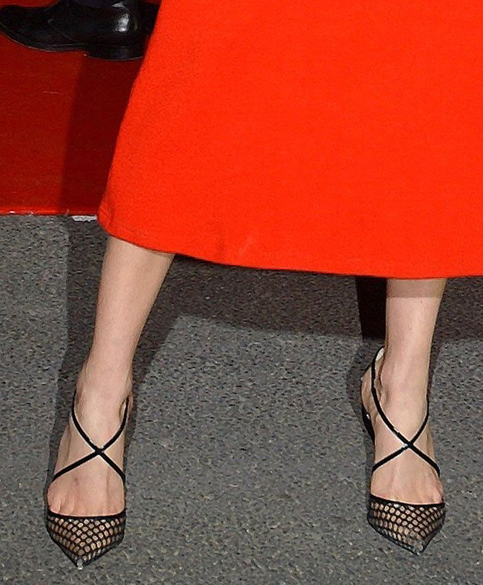Karlie Kloss shows off her feet in Christian Louboutin pumps