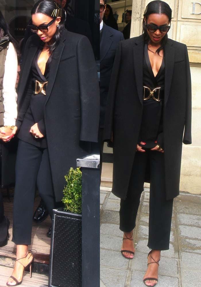 Kelly Rowland wears a black two-piece Haider Ackermann suit during Paris Fashion Week