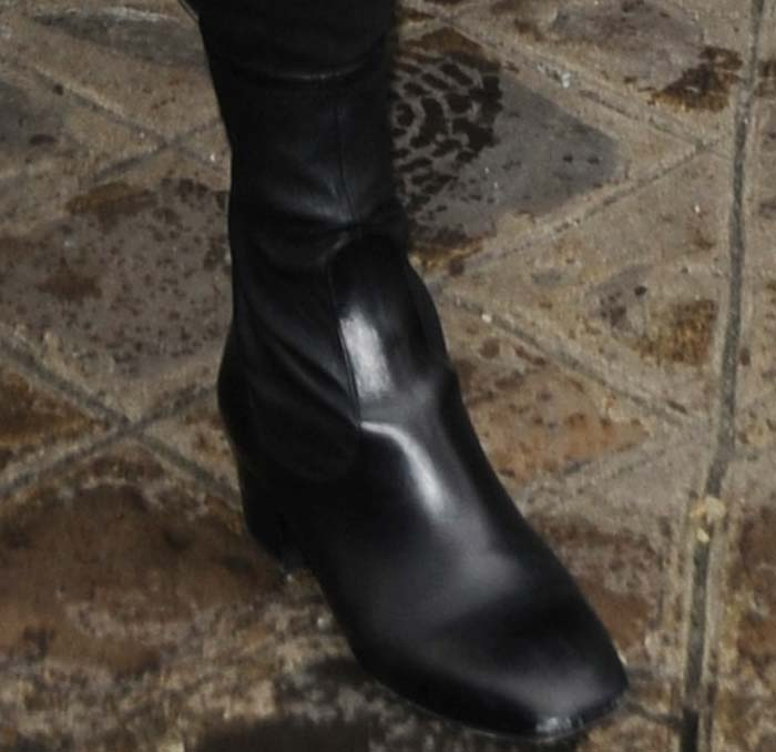 Kendall Jenner wears a pair of black Sandro boots