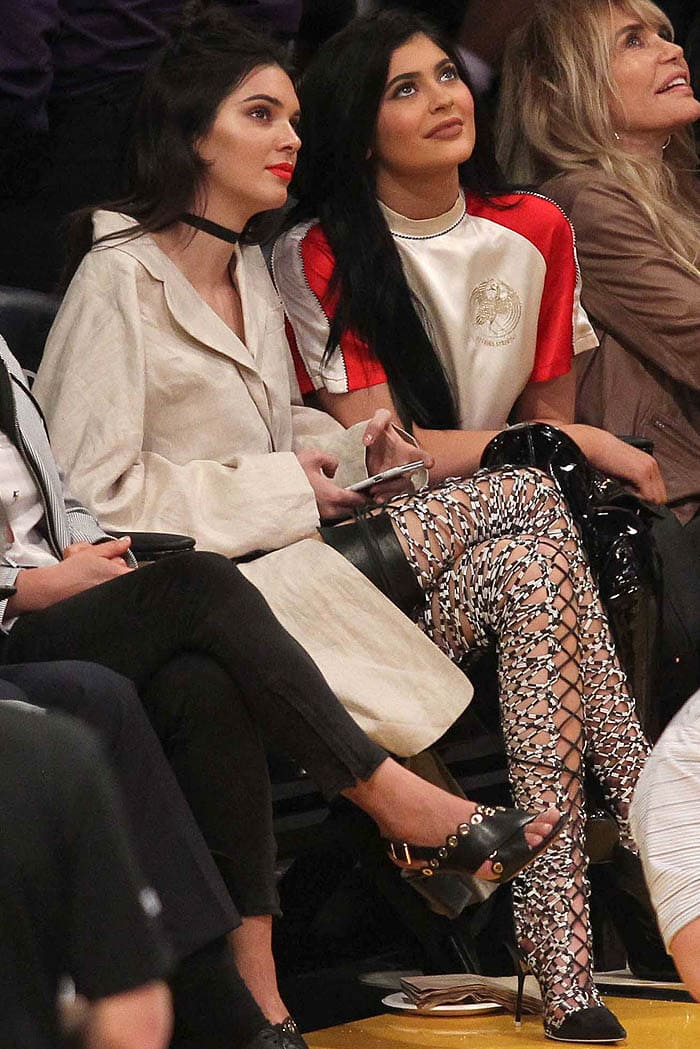 Kendall and Kylie Jenner watching the basketball game between the Los Angeles Lakers and Sacramento Kings at Staples Center in Los Angeles, California, on March 15, 2016
