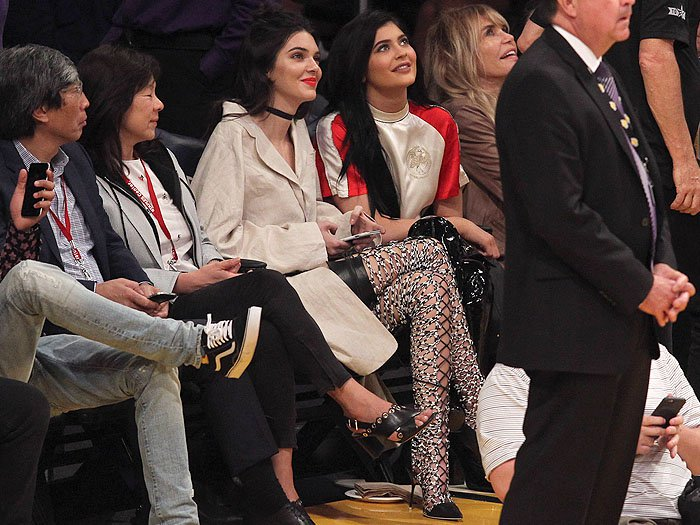 Kendall and Kylie Jenner watching the basketball game between the Los Angeles Lakers and Sacramento Kings